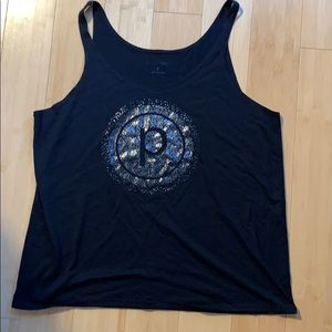 Pure Barre metallic circle P tank